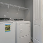 Each unit has a washer and dryer in this handy closet.(Photo of Unit 108)