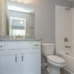 The full bath has a combo tub/shower and beautiful vanity. (Photo of Unit 108)