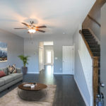 Greet your guests and welcome them to your home from your spacious living room. (Photo of Unit 108)