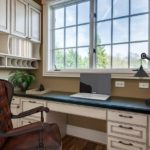 Just off the kitchen tucked away across from the butler's pantry is this cute home office with large desk space and plenty of storage. (This photo has been virtually staged.)