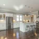 The open kitchen concept includes great island with plenty of prep space. Stainless fridge will remain.