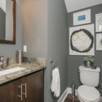 Guest bathroom on the main floor includes all the luxury finishes you would expect from a custom built house.