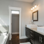 Double vanity and separate water closet round out this elegant master bath.