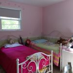 The third bedroom is also on the main level and both bedrooms share a full bath.