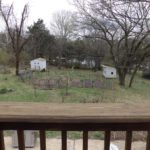 The large yard is an urban homesteader's dream with fig, plum and peach trees, chicken coop, shed and garden beds.