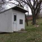 The shed has plenty of room inside to store all your gardening tools and lawn mower.