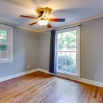The front bedroom has great natural light, gleaming hardwoods, and a good-sized closet.
