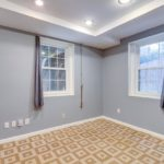 Down the hall is a bright room with two windows that look out to the back yard.