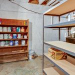 This basement storage room isn't heated or cooled, but would make a great wine cellar!