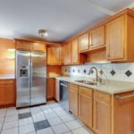 This spacious kitchen has plenty of storage and counter space.