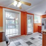 A large window brings in lots of natural light, and the back door is conveniently located for access to the deck.