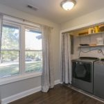 The laundry room is tucked away in this spacious front room, which gives you plenty of space for folding or hang drying your clothes.