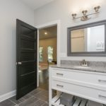 This spacious bathroom has a large vanity sink with an abundance of counter space!