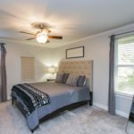 Down the hall, you will find the spacious master bedroom suite, with two large windows that provide tons of natural light.