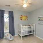 Cozy third bedroom is perfect for the baby or could easily be a home office.