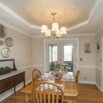 The dining area has lovely architectural touches like the trey ceiling and chair rail.