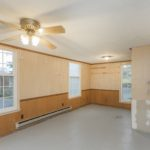 This room used to be the garage (epoxy floor) and was enclosed at some point to make this additional square footage.