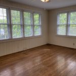 The spacious master bedroom is paneled and has great hardwoods.