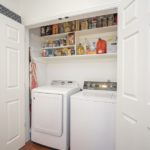 Laundry closet is in the kitchen. Seller installed a vent recently which you will appreciate.