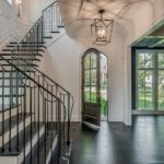 Iron railings and beautiful woodwork are a hallmark of the Craftsman Residential design. (Photo of another luxury Craftsman Residential property)