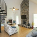 The fireplace is the focal point of this light-filled room.