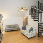 How fun is the cute loft and circular stairs -- this is a perfect study nook for a teen or a hobby room.