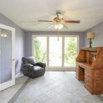 Sunroom, office, library, sitting room -- this versatile room can be whatever you'd like it to be.