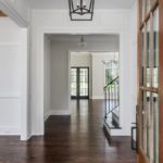 Wide plank hardwood floors and designer lighting is standard in these luxury homes. (Photo of another luxury Craftsman Residential property)
