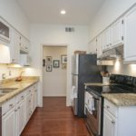 This renovated kitchen is a dream -- stainless appliances, granite countertops, newly vented stove hood, and plenty of cabinets!