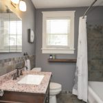 The full bath has been renovated -- additionally, all plumbing and pipes have been replaced all the way to the street.