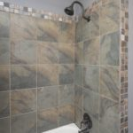 The slate tile surround and new bath fixtures have updated this bathroom to feel like new!