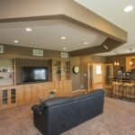 Upper level media room with complete wet bar & fridge - the 7.1 sound system is built in.
