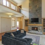 Greet your guests from your two story open living room!
