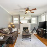Gleaming hardwoods and fresh paint create warmth and will make it one of your favorite rooms. The seller does not use the fireplace and does not warrant it as a working fireplace.