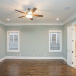 """The downstairs """"primary"""" bedroom measures 16x14 and has gleaming hardwoods."""
