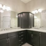 The bathroom is ensuite and includes more luxury finishes & features like double vanities.