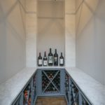 This wine cellar is custom built for this homeowner and includes greenboard drywall, insulated door and holds over 300 bottles of wine. This room and its cooling equipment has the capacity for 1000 bottles of wine.