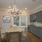 """This virtually staged photo shows you the versatility of the dining room with """"butlers"""" pantry with wet bar & wine fridge."""
