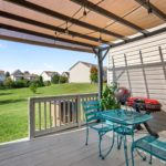The deck includes shade for privacy and sun protection on a hot day.