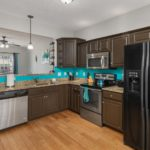Stainless appliances and fun paint color make this kitchen fun!