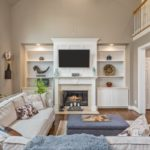 This home has a floor plan for entertaining with the soaring two story ceilings, gas fireplace and built-ins to display your art.