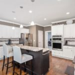 The gourmet kitchen with granite countertops, 2 person island, stainless appliances and tons of counter space will make the chef in your family smile.