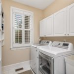First floor utility room with sink will make doing laundry easier.