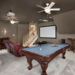 Heading upstairs to the bonus room over the garage, this spacious gathering spot has room for a pool table or ping pong, theater screen or large screen TV and a bar if you wish.