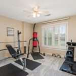 The fifth secondary bedroom on the 2nd level is being used as a home gym by this family.
