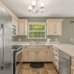 Your new kitchen has stainless appliances including refrigerator, dishwasher, stove and microwave.