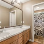 Double vanity and tons of storage space for you with a combo tub/shower completes the primary bath suite.