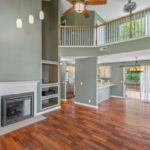 The soaring ceilings and gas fireplace make this the perfect house for entertaining.