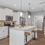 The kitchen has gorgeous countertops and cabinet space along with stainless appliances, including the fridge!