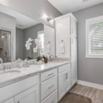 The primary bathroom is en-suite and has double vanity with gorgeous countertops.